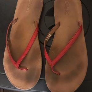 Clark's flip flops red